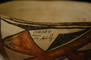 Detail: large Zuni bowl. Smithsonian accession number, name of collector, and place collected.