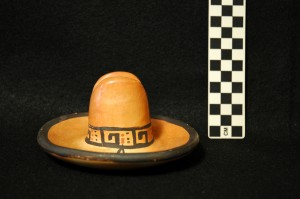 Side view: Ceramic cowboy hat. Potentially used as an ashtray.