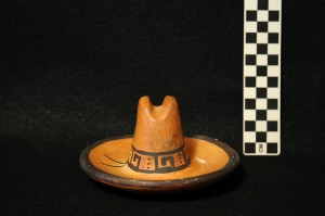 Front view: Ceramic cowboy hat. Potentially used as an ashtray.